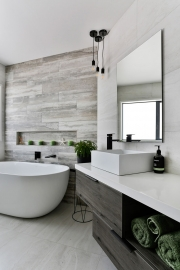 Bathroom with inset shelving
