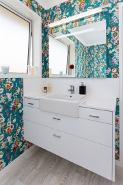 White cabinets in colourful bathroom