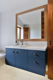Blue cabinets with white stone bench
