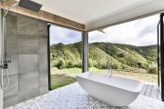 An almost-outdoor bathroom with a view