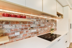 Brick wall with timber floating shelves