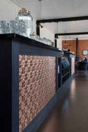 Pressed copper panels set into counter