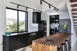 Black matte cabinetry and black appliances