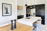 Black lacquer cabinets pair well with American Oak