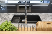 Black undermount sink with Panama channel for herbs and knives