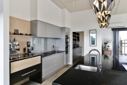 Black and grey kitchen with a hint of warm timber