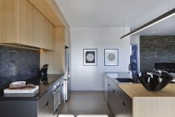 Galley kitchen with recessed handle cabinets