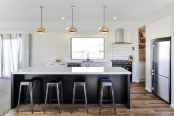 Copper pendant lights above kitchen island