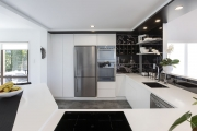 Black and white kitchen with stainless steel appliances