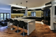 Large U shaped kitchen in black and gold