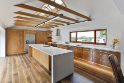 Timber beams above kitchen bench