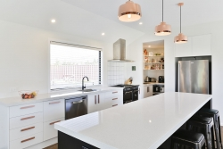 Copper accents in a black and white kitchen