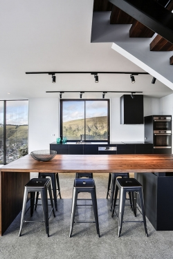 Timber benchtop with matt black cabinetry