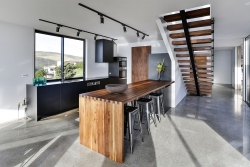 Timber and black in unique kitchen layout