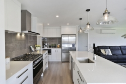 L shaped kitchen with island and scullery