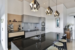 Silver Haze cabinets with black granite benchtop