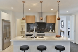 White kitchen with woodgrain feature cabinets