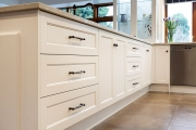 White country kitchen cabinets, black handles