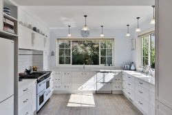 Large white U shaped country kitchen