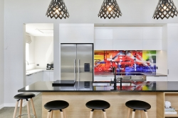 White kitchen with bright splashback
