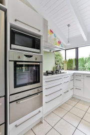 Wall oven with warmer drawer and microwave in-built