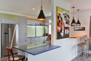 Engineered stone benchtop with blue Formica extension
