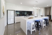 White 50mm thick kitchen bench with waterfall ends