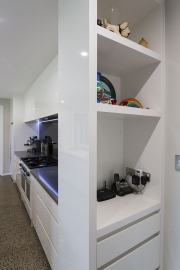 Clever corner shelving inset into wall