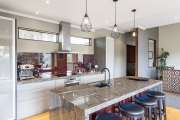 Granite, stainless steel and burgundy kitchen