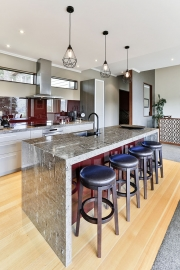 Large kitchen island with waterfall ends