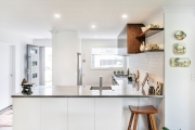 Corner kitchen with overhead cabinets