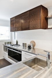 Stainless steel, white and timber kitchen