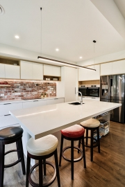 Kitchen island with overhung bench
