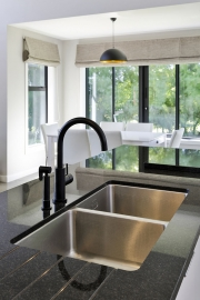 Black granite benchtop with undermount double sink