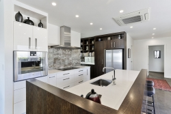 Wood grain mixed with high gloss white cabinets