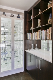 Drinks corner with glass display cabinets
