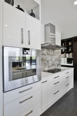 White and woodgrain galley kitchen