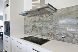 Grey textured tile splashback