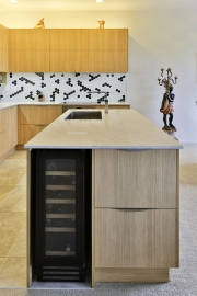 Wine fridge with dual dish drawers in kitchen island end