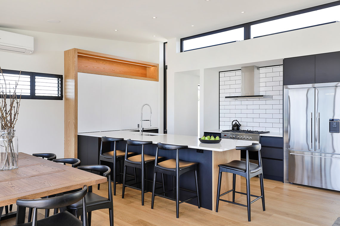 Black and white kitchen with timber