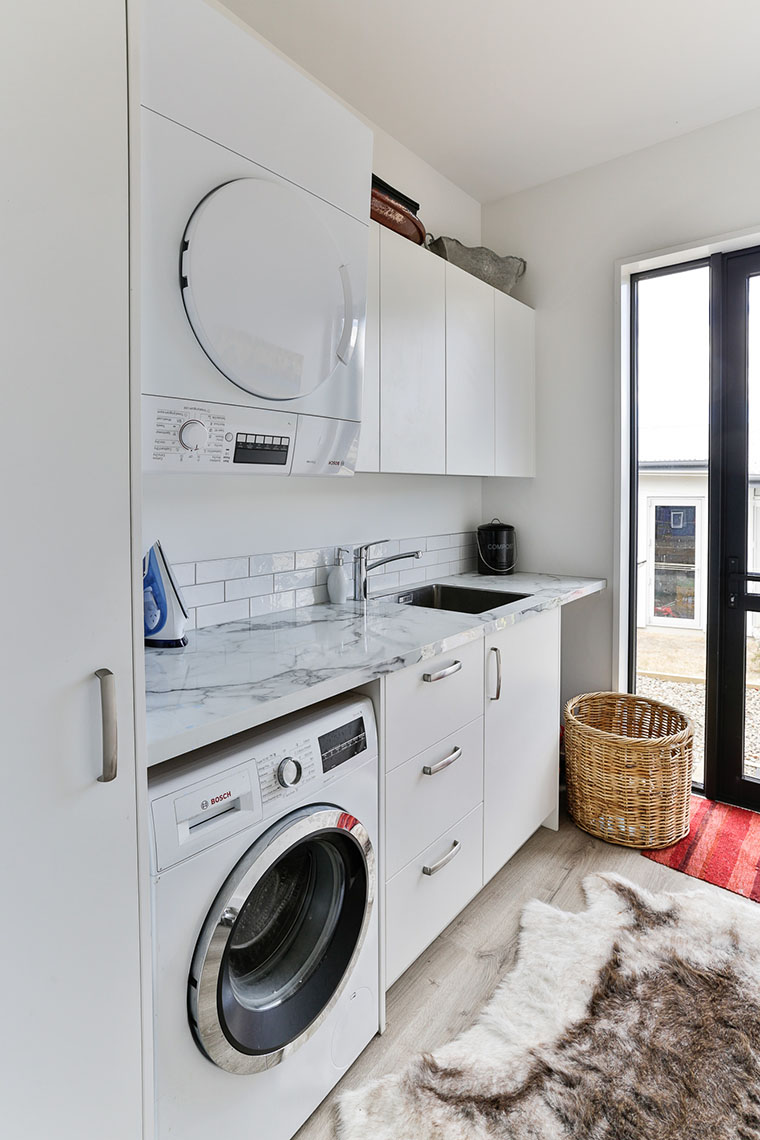 Laundry with granite benchtop