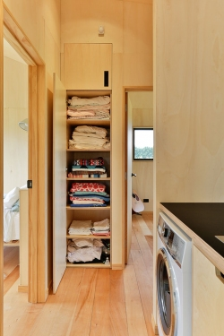 Plywood laundry - linen cupboard open