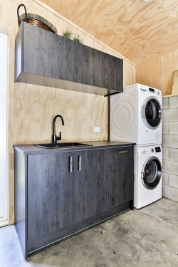 Laundry - plywood walls with dark timber veneer
