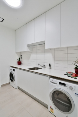 Laundry with subway tiles and long bench