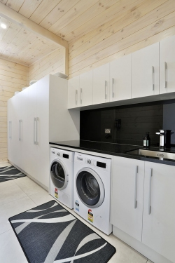 Laundry with side-by-side washer/drier