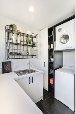 Compact laundry with wire shelves