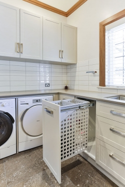 Laundry with pull-out hide-away hamper