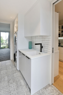 Stone benchtop in white laundry