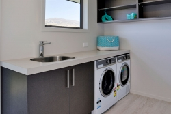Timber veneer cabinets in laundry