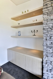 Custom-made floating shelves and cabinets